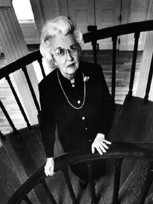 In this 1988 photo, University of Iowa professor emerita Margaret Keyes stands on the spiral staircase inside the Old Capitol on the UI campus. Keyes died Oct. 14, 2015, at age 97.