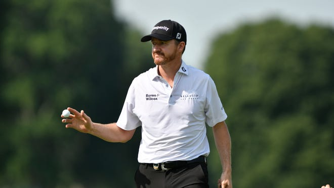 Jimmy Walker reacts to the crowd after making a putt on 17th hole during the first round of the 2016 PGA Championship golf tournament at Baltusrol GC - Lower Course.