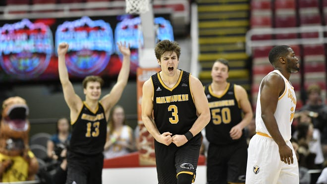 Brian Stull (3) and his UWM teammates celebrate their victory Saturday at Joe Louis Arena in Detroit.
