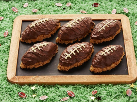 Scotcheroos, a midwestern treat, can be shaped into footballs for a Super Bowl party.