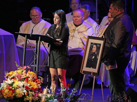 Jennifer Rivera, the girlfriend of slain Dallas police Officer Rogelio Santander, talks about him at his funeral Tuesday at Lake Pointe Church in Rockwall, Texas. Santander was fatally shot last week while questioning a suspected shoplifter at a Home Depot store.