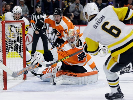 Philadelphia Flyers' Michal Neuvirth (30) cannot stop a goal by Pittsburgh Penguins' Jamie Oleksiak (6) during the third period of an NHL hockey game, Tuesday, Jan. 2, 2018, in Philadelphia. Pittsburgh won 5-1. (AP Photo/Matt Slocum)