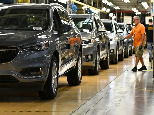 Buicks roll off the line at General Motors' Lansing
