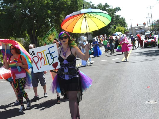 The CommUNITY Pride Parade makes its way down California Ave. towards Wingfield Park in Reno on July 22, 2017. Jason Bean/Reno Gazette-Journal- USA TODAY NETWORK