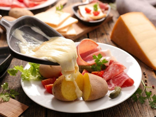 Raclette is the perfect cheesy topping to a variety of other ingredients.