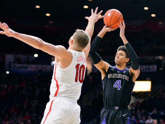 Washington's Matisse Thybulle shoots over Arizona's Ryan Luther during a game on Feb. 7.