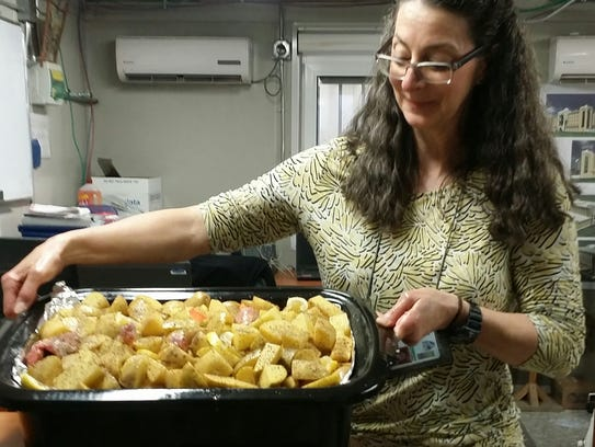 Margie Jednat in Kabul with four-chicken stew she made