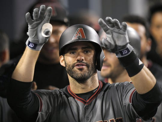 J.D. Martinez gestures toward the camera after hitting