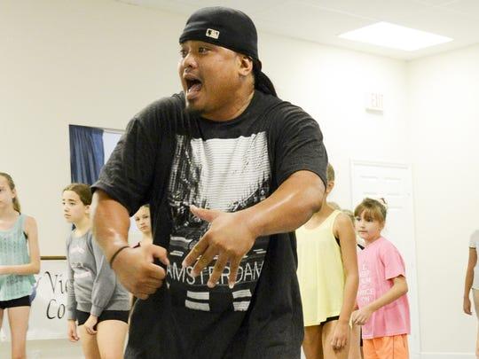 B-boy dancer Nestor Funelas teaches hip-hop at Viera Dance Conservatory in Melbourne.