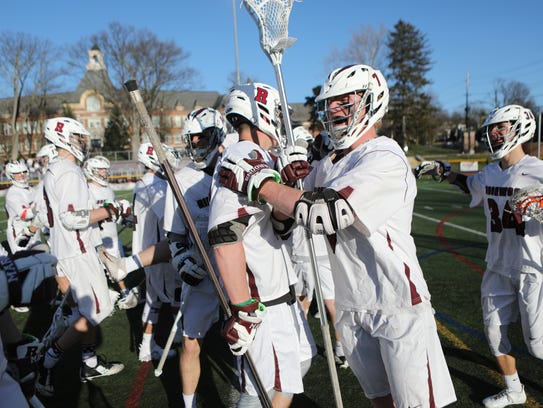 Jack Kennedy (7) and Ridgewood celebrate their 10-6