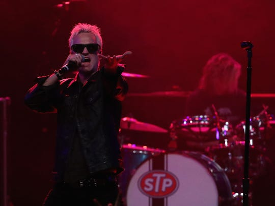 Singer Jeff Gutt performs as the lead singer of Stone