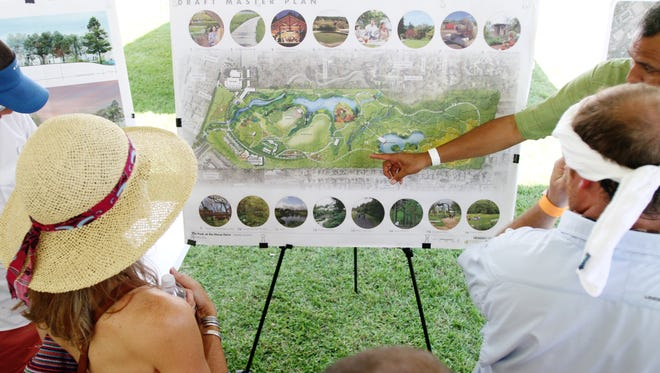 Residents take a look at the master plan for the Park at the Horse Farm. The plan included 16 sections of the park.