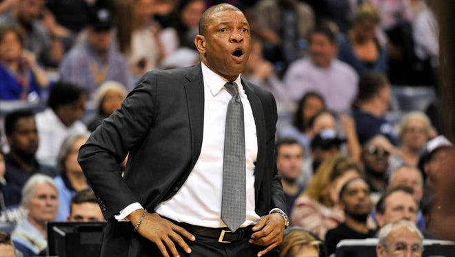 Los Angeles Clippers head coach Doc Rivers calls to players in the second half of an NBA basketball game against the Memphis Grizzlies Saturday, March 19, 2016, in Memphis, Tenn.
