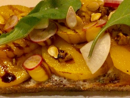 Butternut squash atop slices of house sourdough with