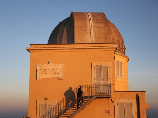 Brother Guy Consolmagno, a native of metro Detroit and one of 12 Vatican astronomers, climbs the steps of one of the two observatories on top of the Papal summer residence in Castel Gandolfo, Italy.