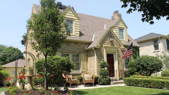 A sunny, flowery front yard is presented by this 2017 West Allis Beautification Award winner at 2421 S. 59th St.