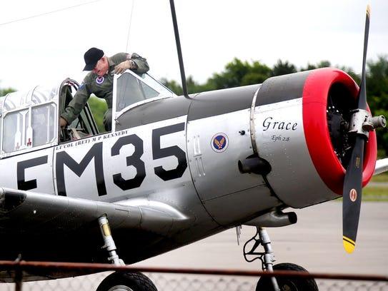 Pilot Michael Kennedy, Lt. Col USAF (ret) climbs out