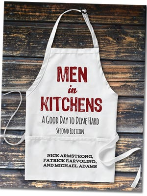 The cover of the locally published book called Men in Kitchens: A Good Day to Dine Hard. The cookbook includes recipes from a Rocky Mountain High School graduate.