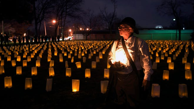 Civil War re-enactor Ed Vaughn stands among luminaries in a field near the Carter House in Franklin. Each year on Nov. 30, the Battle of Franklin Trust hosts the annual Illumination, in which 10,000 luminaries are laid out to represent the 10,000 casualties from the Battle of Franklin in 1864.