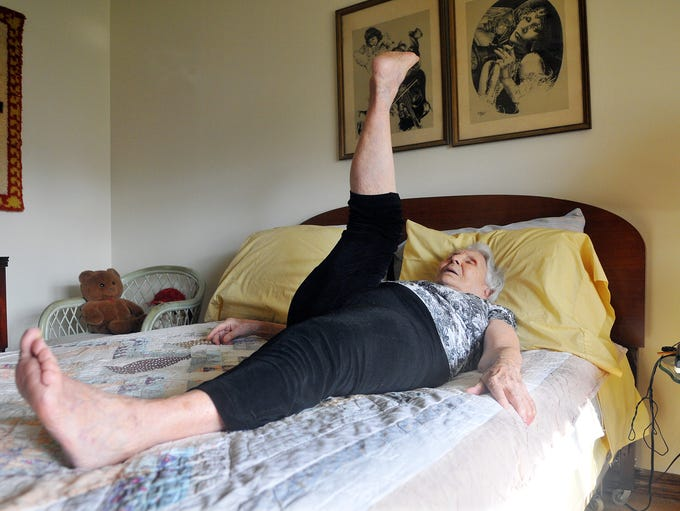 "Before she even gets out of bed, Angelina Burns, 96, of Titusville, exercises with her ""Rockette kicks."""