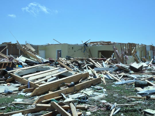 Damage Winston County tornado did to home of Louisville baseball coach Charlie Smith.