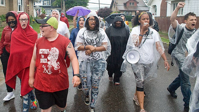 Sierra Mason (holding microphone) of the Ohio Community Coalition, leads a Black Lives Matter peaceful protest through the streets of Minerva.