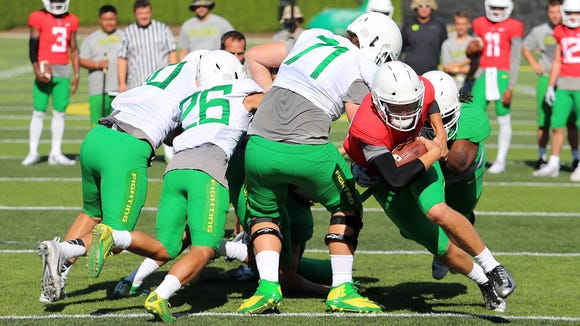 Oregon freshman quarterback Justin Herbert competes during practice.