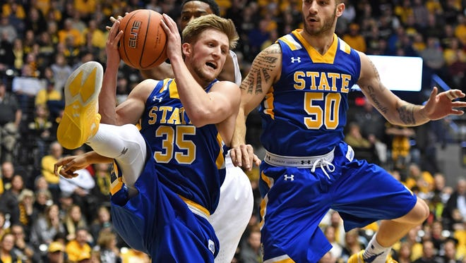 South Dakota State Jackrabbits guard A.J. Hess (35) pulls down a defensive rebound against the Wichita State Shockers during the first half at Charles Koch Arena. Wichita State won 89-67. Mandatory Credit: Peter G. Aiken-USA TODAY Sports