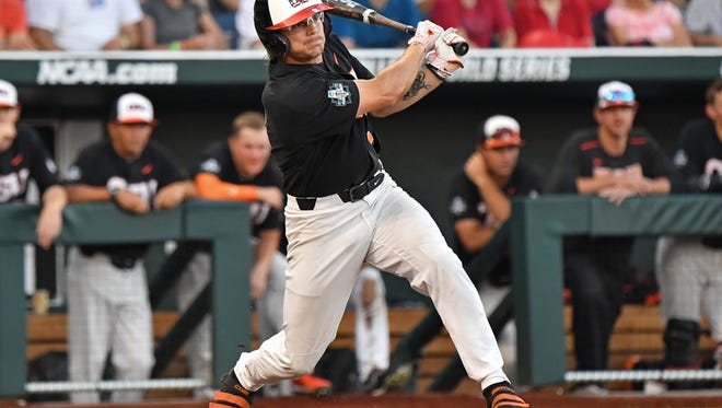 Infielder Cadyn Grenier #2 of the Oregon State Beavers singles in the fifth inning against Arkansas Razorbacks during game one of the College World Series Championship Series on June 26, 2018. Grenier will join the Delmarva Shorebirds in the summer of 2018 as the Baltimore Orioles first-round draft pick.
