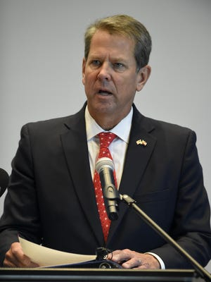 FILE - Georgia Gov. Brian Kemp speaks during grand opening/ribbon-cutting of the Perspecta office at the Georgia Cyber Center Tuesday afternoon October 6, 2020 in Augusta, Ga.