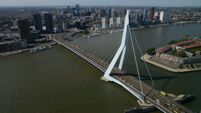 The city of Rotterdam, the Erasmus Bridge and the River Maas as seen from the top of The Rotterdam.