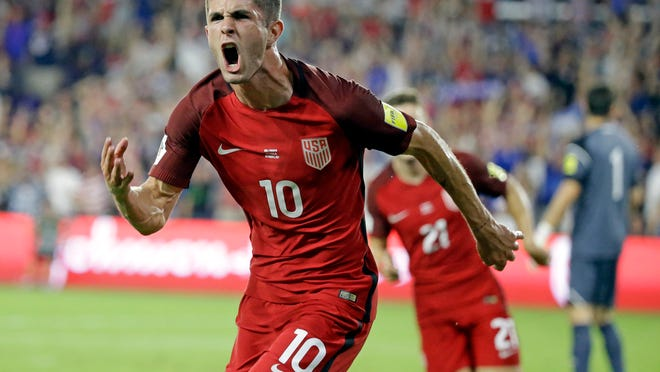 United States' Christian Pulisic (10) celebrates after scoring a goal against Panama during the first half of a World Cup qualifying soccer match, Friday, Oct. 6, 2017, in Orlando, Fla. (AP Photo/John Raoux)