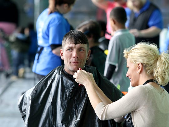 Debbie Sellers of Harrison gives a shave to Derick