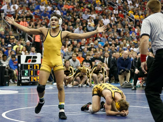 Bettendorf's Fredy Stroker wins in the finals of the