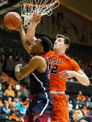 Feb 2, 2017; Corvallis, OR, USA; Arizona guard Allonzo Trier (35) drives to the basket as he is guarded by Oregon State forward Drew Eubanks (12) during the second half at Gill Coliseum. The Wildcats won 71-54.
