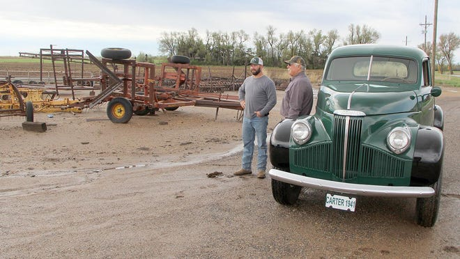 Gary Barker (right), son of the late Carter Barker, and business partner Trey Langford look over the selection at the Carter Barker Equipment lot just east of Pratt. The pair took over the business operation after Barker died in October 2019. Carter Barker's iconic 1941 Studabaker pickup just had to be in on the review, as well.