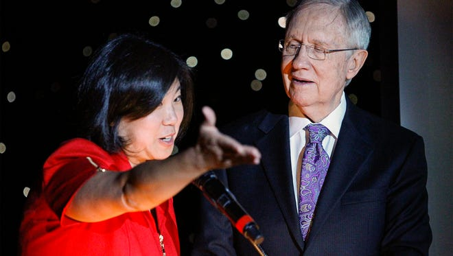 In this photo taken on Aug. 21, 2014, U.S. Rep. Grace Meng, D-Queens,  and U.S. Sen. Harry Reid, D-Nev., take the stage during the Asian Chamber of Commerce's monthly lunch at the Gold Coast casino-hotel in Las Vegas.