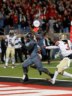 Michael Dyer's second touchdown Thursday put U of L up 14-0.