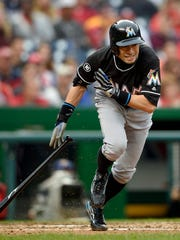 Miami Marlins' Ichiro Suzuki, of Japan, runs towards first during a 2016 game. The 43-year-old reserve outfielder returns this spring, and will build on his career total of 3,030 hits.