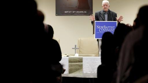 Former President Jimmy Carter speaks at a Baptist conference Thursday in Atlanta. Carter says the United States is experiencing 'a resurgence of racism' and called on Baptist faith leaders to lead change in their communities. The former U.S. president spoke Thursday at a summit hosted by the New Baptist Covenant, an effort he formed in 2007 to unite Baptists. Carter says some white Americans stay quiet when they see racism or discrimination, fearful of losing a 'position of privilege' in society.