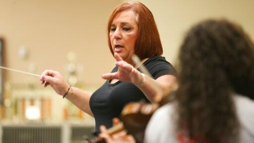 Stephanie Byers conducts a band class at Wichita North High on April 23, 2018. Byers ran unopposed and won Tuesday's Democratic primary in the 86th District of the Kansas House of Representatives. Byers has since retired from teaching.