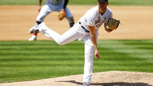 Colorado Rockies starting pitcher Jon Gray works against the Texas Rangers in the fourth inning on Sunday at Coors Field in Denver.