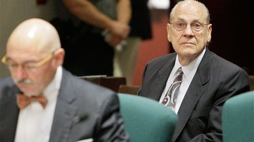Retired Tampa Police Capt. Curtis Reeves Jr., right, attends a pretrial hearing before Circuit Judge Pat Siracusa today. Judge Pat Siracusa set a March 2 trial date and said he wants to move the case along as quickly as possible for the sake of the families involved.  Reeves is charged with fatally shooting Chad Oulson, 43, and wounding his wife, Nicole during an argument over texting at a movie theater in Wesley Chapel, Fla., in January. At left is his attorney, Dino Michaels.