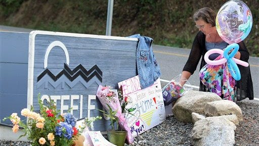 Karole Johnson places balloons of princesses and flowers at the entrance sign to the Steele Creek Mobile Home Park, Thursday, Aug. 7, 2014 in Bremerton, Wash.  A four-day search for a missing Washington girl who vanished from her home over the weekend came to a tragic end Thursday, as authorities said they believe they have found the body of 6-year-old Jenise Wright. (AP Photo/Kitsap Sun, Larry Steagall)