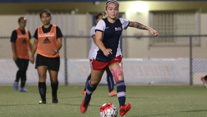 Quality Distributors' Paige Surber looks for a teammate to pass the ball to against the Bank of Guam Lady Strykers during an opening day match of the 2016 Bud Light Women's Soccer League Fall season on Sunday at the Guam Football Association National Training Center. The teams battled to a 2-2 draw.