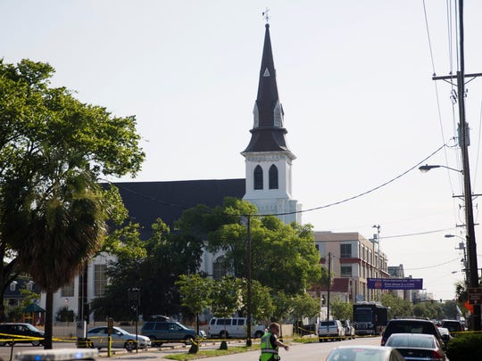The steeple of Emanuel AME Church rises above the street