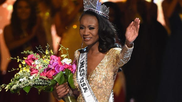 Miss District of Columbia Deshauna Barber waves to the crowd after being crowned Miss USA.