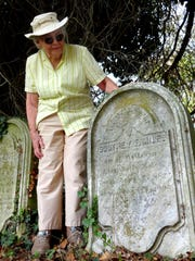 Suzanne Coons, 84, looks at the tombstone of Southey F. Miles, a Confederate sympathizer who killed a Union solider in Somerset County.