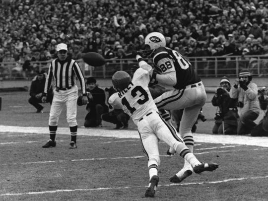 From Dec. 20, 1971: Bengal's Gamble Just Misses...Ken Riley makes a headlong attempt at intercepting a sideline pass to Jets' Rich Caster.