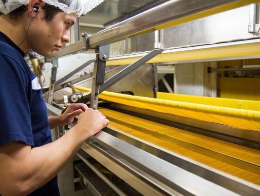 1-Pasta Montana employee oversees cutting